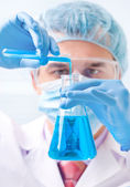 Researcher working with chemicals — Stock Photo