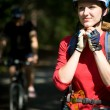 Womcyclist wears helmet — Stock Photo #41420263