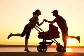Happy family walking on sunset — Stock Photo