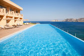 Swimming pool on sea resort — Stock Photo