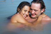 Man and woman  in open water — Stock Photo