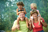 Mom and dad with children — Stock Photo
