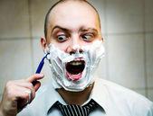 Man shaves — Stock Photo