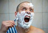 Man in the bathroom — Stock Photo