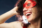 Playful woman in carnival mask  — Stock Photo