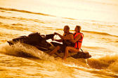 Couple on jet boat — Stock Photo