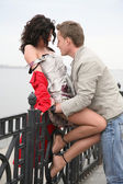 Couple on the embankment — Stock Photo