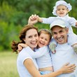 Happy family in  summertime — Stock Photo #50733691
