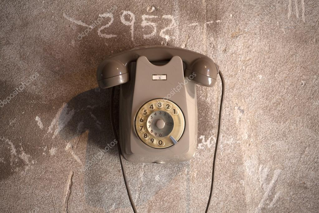 View of Old italian telephone on dirty wall  Stock Photo #12596621