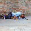 Homeless sleeping in the street - Stock Photo