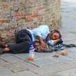 Stock Photo: Homeless sleeping in street