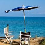 Beach umbrella and chair — Stock Photo #1454943