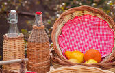 Bottles and wicker baskets — Stock Photo