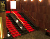 Stairs with red carpet — Stock Photo