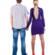 Back view of young embracing couple — Stock Photo #12658003