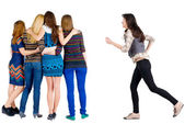 Girl hastens to join friends — Stock Photo