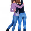 Two women pointing at wall. Rear view. — Stock Photo