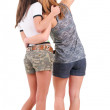 Back view of two young women pointing. — Stock Photo