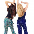 Back view of two beautiful young woman dancing — Stock Photo #13755178