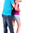 Back view of young couple pointing at wall — Foto de Stock