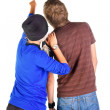 Backview of young couple interestedly looks at white. — Stock Photo