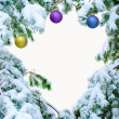 Stock Photo: Snow covered fir branches with Christmas balls