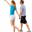 Back view of walking young couple - Stock Photo