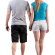 Back view of going young couple (man and woman) — Stock Photo #22267031