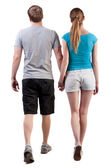 Back view of going young couple (man and woman) — 图库照片