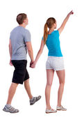 Back view of walking young couple — Stock Photo