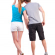 Back view of young couple pointing at wall — Stock Photo #23115046