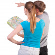 Back view journey of the young couple looking at the map - Stock Photo