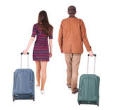 Back view of walking couple with suitcase. — Stock Photo