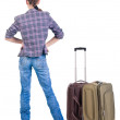 Back view of traveling brunette woman in jeans with suitcase loo — Stock Photo