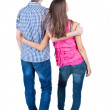 Young couple pointing at wall Back view (woman and man) — Stock Photo #29050837