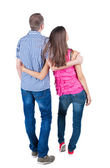 Young couple pointing at wall Back view (woman and man) — Stock Photo