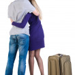 Back view of traveling young couple with suitcas — Stock Photo