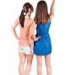 Two long haired friendly women pointing . — Stock Photo