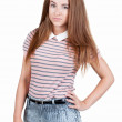 Stock Photo: Red-haired teen girl in shorts.