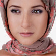 Portrait of white-skinned girl in a turban. — Stock Photo