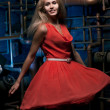 Blonde in a red dress — Stock Photo