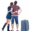 Young traveling couple with suitcas looks where that. — Stock Photo #31926089