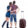 Young traveling couple with suitcas looks where that. — Stock Photo #31926783
