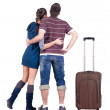 Young traveling couple with suitcas looks where that. — Stock Photo #31926821