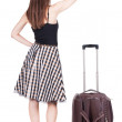 Woman traveling with suitcas — Stok fotoğraf