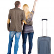 Couple traveling with suitcas — Stockfoto