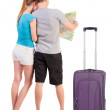 Back view journey of the young couple looking at the map — Stock Photo #36334737