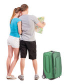 Back view journey of the young couple looking at the map — Stock Photo