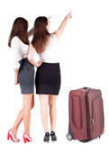 Back view of businessteam traveling with suitcase. — Stock Photo