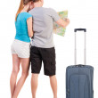 Back view journey of the young couple looking at the map — Stock Photo #37074897